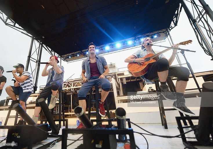 (L-R) Carlos Pena Jr., Logan Henderson, James Maslow and Kendall Schmidt of Nickelodeon's Big Time Rush perform during their free concert for families on July 22, 2013 in Newtown, Connecticut.  (Photo by Michael Loccisano/Getty Images for Nickelodeon)