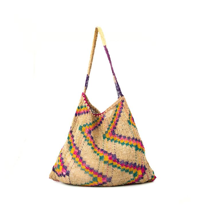 This traditional bilum has been modernised by blending plain and coloured natural fibres to create a unique pattern. The 'bush' rope used to weave the bilum is made from 100% natural fibre using the traditional technique of hand rolling plant fibres into twine over the knee. The process is carried out by women who then use natural materials such as berries, leaves and muds to dye the fibres, before weaving them into bilums of many different sizes and patterns. Each pattern tells...
