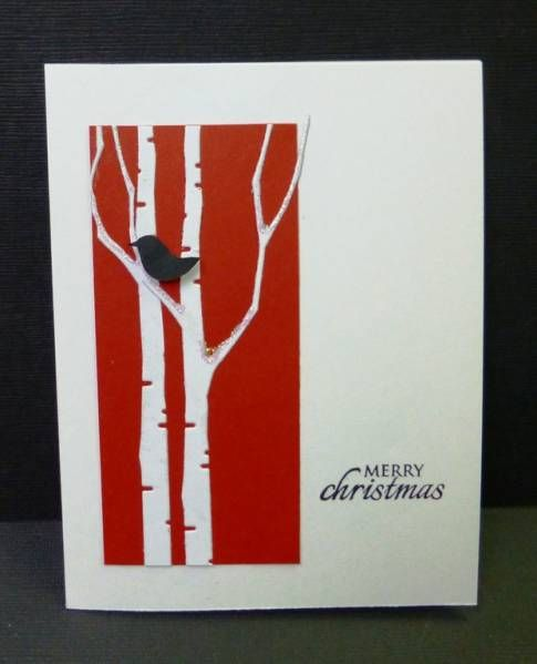stunning card with die cut birch trees on red...delightful...like the little touches: black bird in tree, a bit of sparkly snow on the branches...