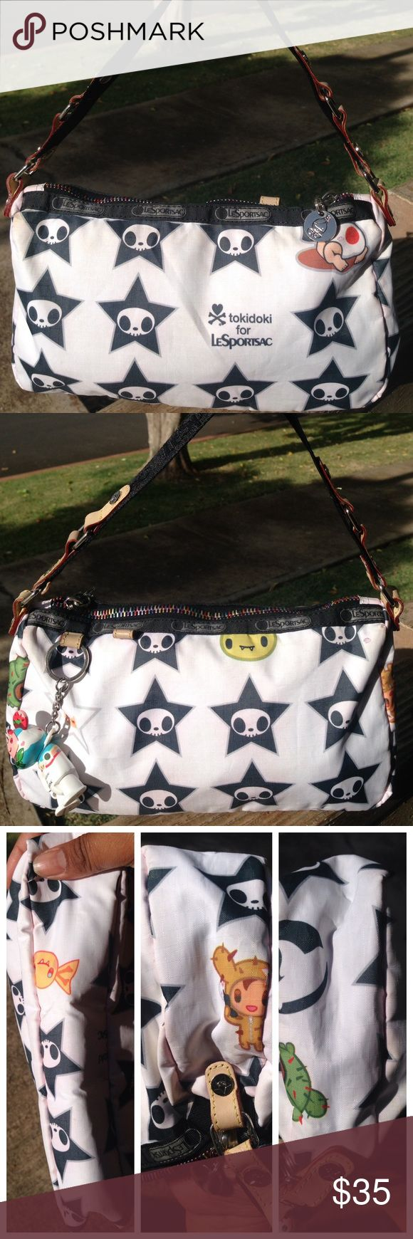 Tokidoki Adios Star Skull Gioco Handbag Bag Qee Tokidoki Lesportsac Black White Adios Star Skull Gioco Handbag Purse Bag Qee    PreLoved  Small handbag   Has Qee but missing an arm  RIRI zipper , runs smooth   Corners and stitching is tight  Liner is very clean tokidoki Bags Mini Bags