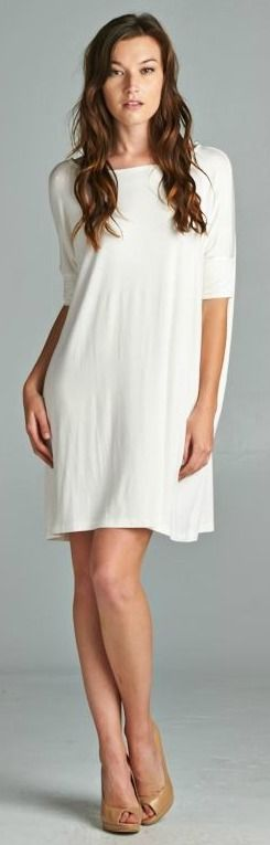"""Loose fit tunic dress. Round neck. Drapes well. Length: 31"""". 95% Rayon, 5% Spandex. Made in USA."""