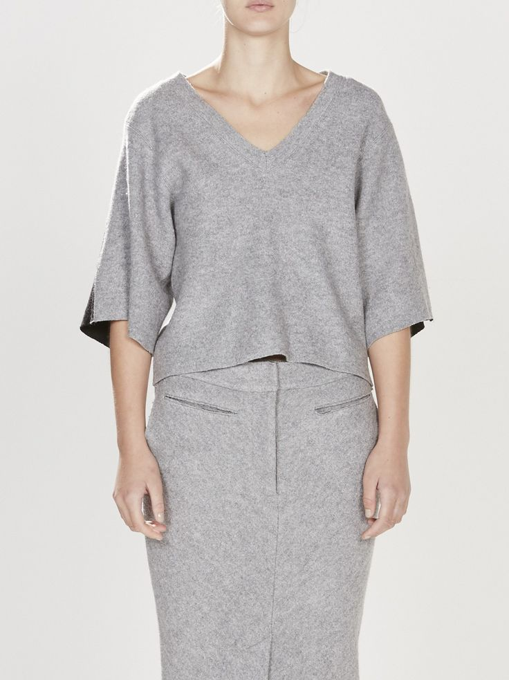 wool felt v neck t.shirt / grey/black: v neck t.shirt in felted wool with wide elbow length sleeves. back yoke panel is contrast black felted wool. raw edge finish on neckline, sleeves and body hem.made in australia.product code: aw15wft56