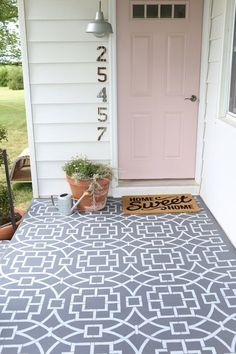 Painted cement floor using a stencil to create a cement tile look. Wow! What a way to make a statement on the exterior of your home!