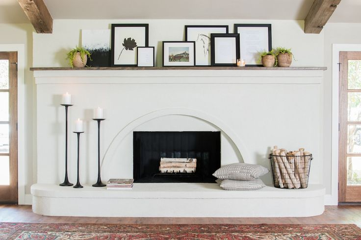 The fireplace was definitely the anchor of the entire main living space. It was out of date and needed something to freshen up its look. We decided to keep the original shape and character of it, but cover the brick in white stucco to give it a more modern look.