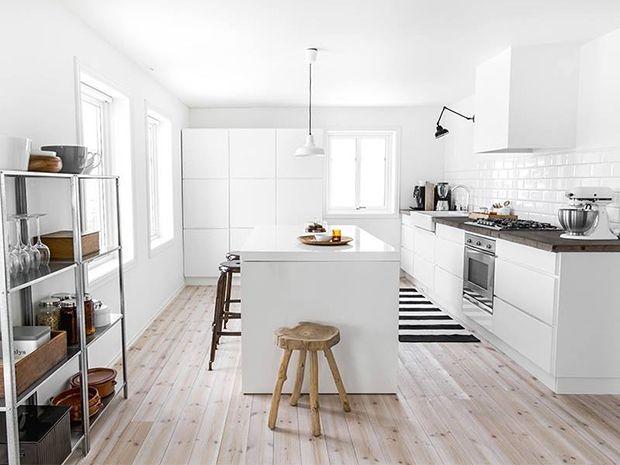 Kitchen in white with a wooden floor via My World apart