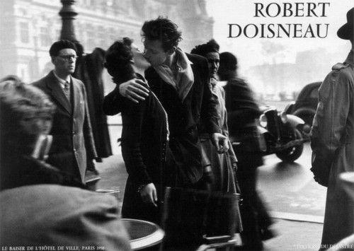 The Kiss  http://oneslidephotography.com/wp-content/uploads/2011/12/Robert-Doisneau-Photography-Kiss-by-the-Hotel-de-Ville.jpg