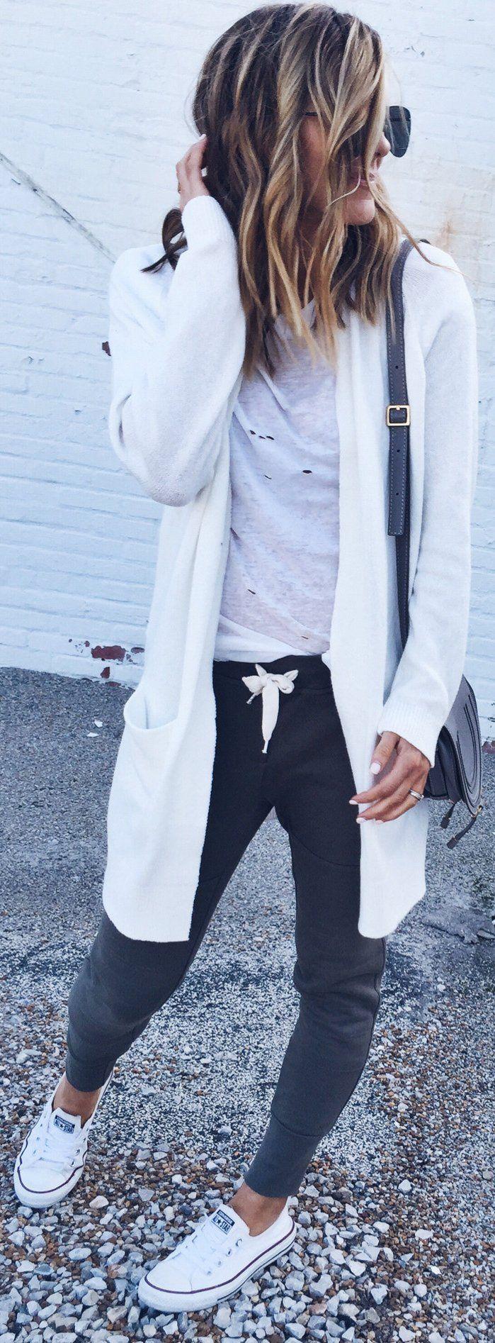 White Cardigan / White Ripped Top / Dark Pants / White Sneakers