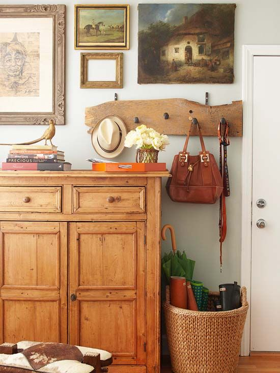 A rack of hooks for hats, bags, and a dog leash takes on the appearance of artwork when hung among a smattering of paintings and frames: http://www.bhg.com/home-improvement/storage/friendly-and-functional-entries/?socsrc=bhgpin042414almostlikeart&page=4