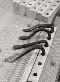 Hand-forged holdfasts we tested, front to back: Phil Koontz, two by Don Weber, a prototype from Tools for Working Wood.