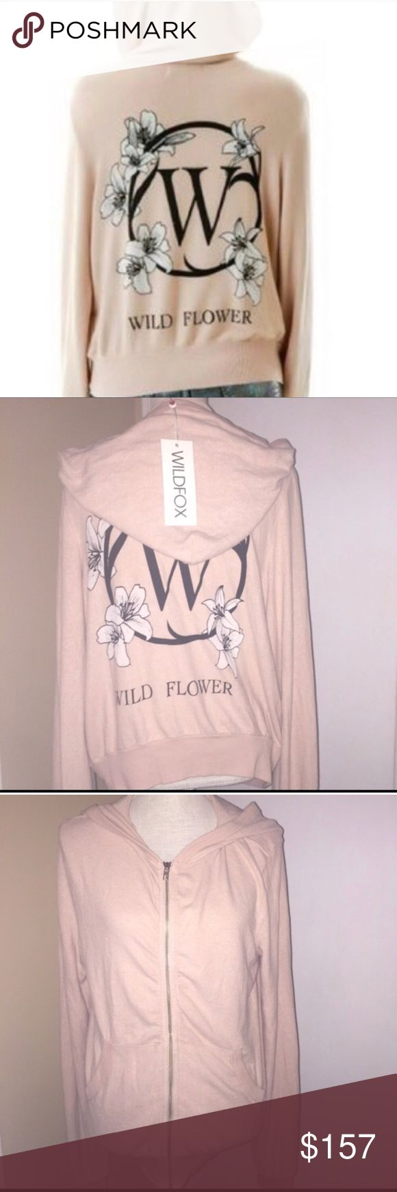 🆕 Wildfox 'Wild Flower' Malibu Zip-up hoodie M NWT Wildfox Couture Malibu Zip-up hoodie with a 'W' and floral design on the back and 'Wild Flower' written underneath. Very pretty neutral color. Size Medium. This is the same material as the very soft baggy beach jumpers. Please view all photos and ask any questions you may have prior to purchasing 💞  ❌No Trades❌    ⭐️Bundle and Save⭐️ Wildfox Couture Tops Sweatshirts & Hoodies