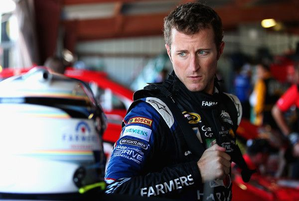 Kasey Kahne Photos Photos - Kasey Kahne, driver of the #5 Farmers Insurance Chevrolet, stands in the garage area during practice for the NASCAR Sprint Cup Series Federated Auto Parts 400 at Richmond International Raceway on September 9, 2016 in Richmond, Virginia. - Richmond International Raceway - Day 1