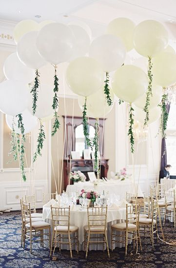 white wedding balloons with greenery