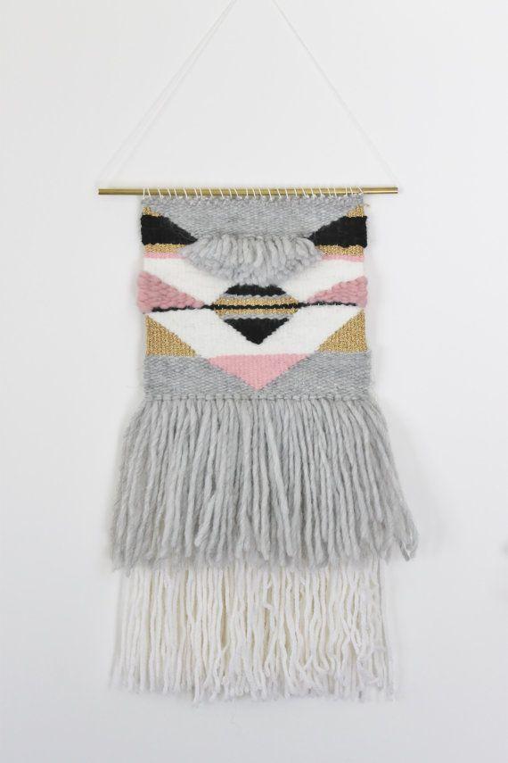 This wall hanging is made with love in France. It is a unique piece, made out of wool and blended acrylic-wool yarn// tissage fait main dans les Alpes. Composé dun mélange de laines et de laine-acrylique. It is hanging on a brass tube// le tissage est suspendu sur un tube en laiton. Dimensions: 8.2 X 17.7 including fringes  21 cm X 45 cm avec les franges