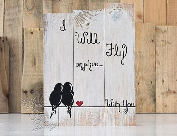 Reclaimed Wood Signs 5 year Gift Wedding Gift for Couple Love Birds on a Wire Art 5th Anniversary Gift Rustic Wood Sign Wedding Pallet Signs  Love Birds on a Wire An original painting on reclaimed wood from Linda Fehlen Gallery  {SIZE} - 20 5/8 x 10 5/8 This is made and READY TO SHIP! Ready to Hang! Wire attached. It looks great resting on a shelf or mantel also.  This painting shows a simplistic scene with a sweet pair of love birds on a wire with a red heart. The whimsical words I Will Fly…