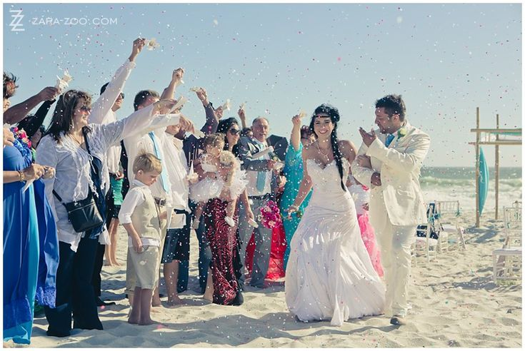 """Traditional punched paper confetti used for this beach wedding in Yzerfontein.  As the beach is """"biodegradable heaven"""" any fast degradable natural material can be used here as long as it is used in small quantities. See more of this wedding on the ZaraZoo blog - http://www.zara-zoo.com/blog/wedding-photos-in-yzerfontein-white-house"""