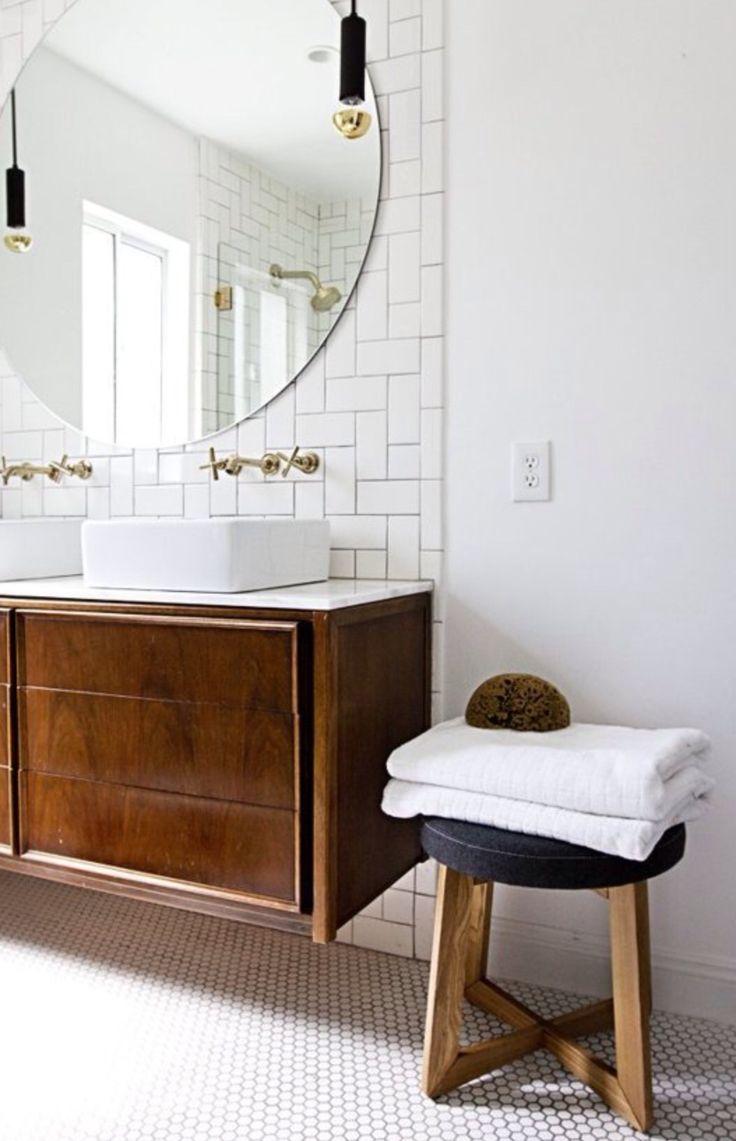 """Floating Vanities, Kohler """"purist"""" brass faucets, herring bone subway tile."""