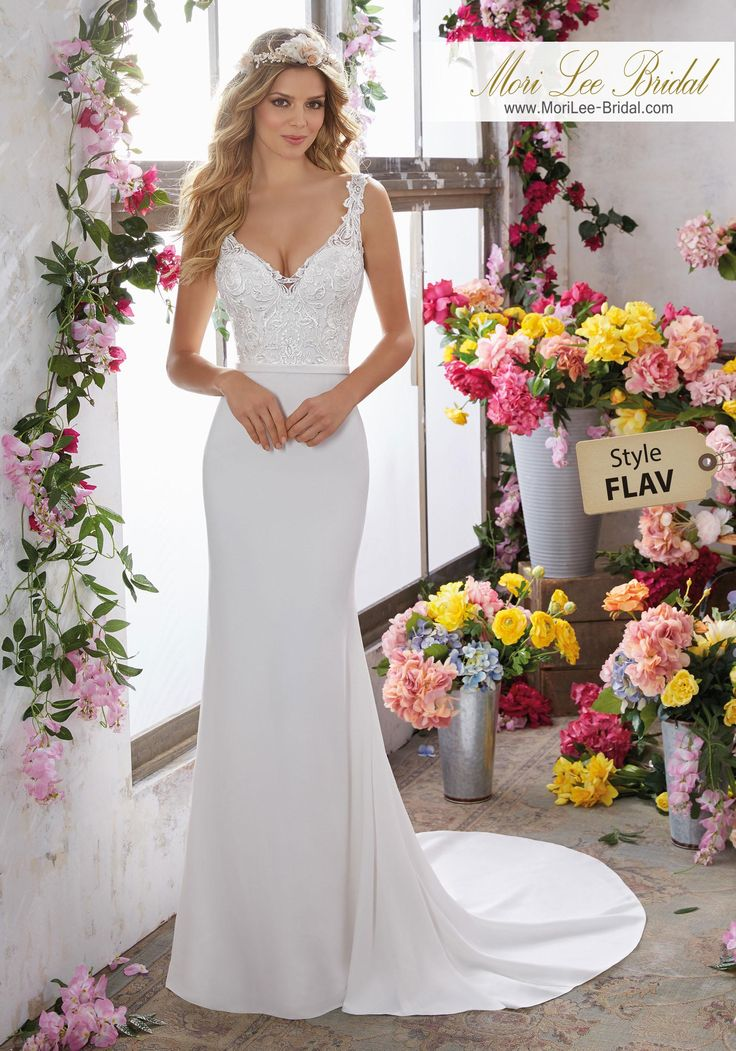 Style FLAV Megan Wedding Dress  Frosted, Embroidered AppliquŽés Adorn the V-Neck and Bodice on This Beautiful Crepe Sheath. Colors Available: Ivory. Shown in Ivory.
