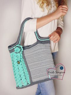 This tote has a fun mix of solid and open lacier crochet. It is the perfect blend of modern and old fashion accessories! It is a larger tote, but it's perfect for on to go gals!