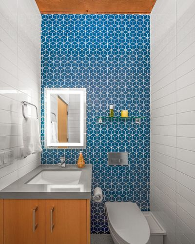 Midcentury Powder Room. The blue tile is the Mural Collection by Heath Ceramics
