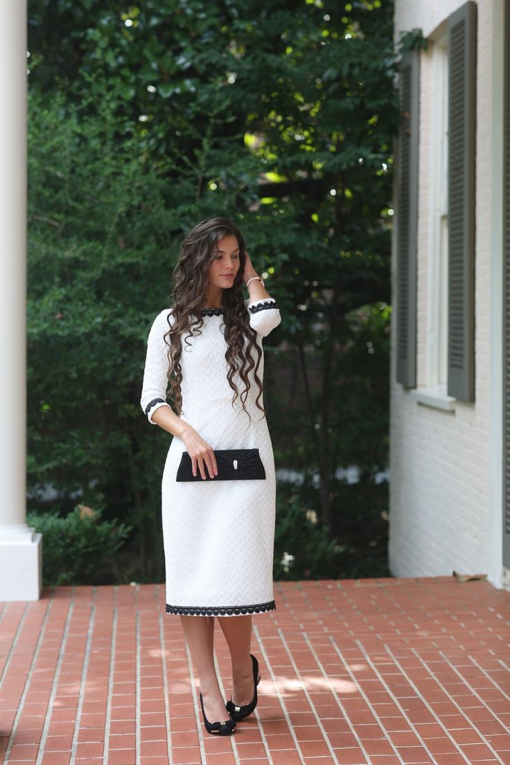 Modest white Alexandria Dress with black lace trim. Modest apparel and bridesmaid dresses. www.daintyjewells.com