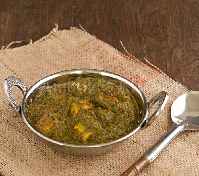 Saag Paneer - Recipe for a restaurant favorite, spinach and paneer cheese cooked in a mild gravy. An easy and flavorful recipe
