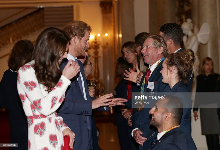 Catherine, Duchess of Cambridge and Prince Harry meet Nick Skelton and athletes at a reception for Team GB's 2016 Olympic and Paralympic teams hosted by Queen Elizabeth II at Buckingham Palace October 18, 2016 in London, England.