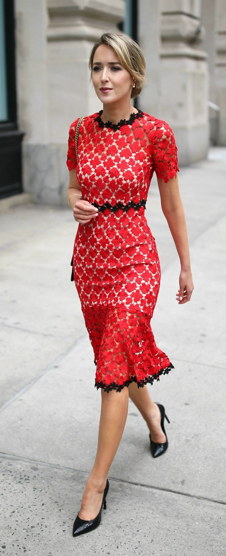 what to wear to a wedding // cocktail attire wedding guest // red lace fit and flare sheath trumpet dress with black lace piping at waist, neckline and hem // open cut-out back and short sleeves midi dress