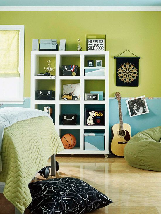 Love the use of the Expedit from IKEA with casters on the bottom.  Also love the colors and the guitar.  Reminds me of the look I was going for in B's room.