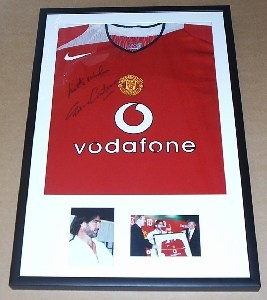 Frame your boys first football kit - get them to sign it first and put it on their bedroom wall!