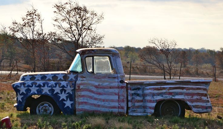 People jump the fence to take pictures with this old truck in West Texas.