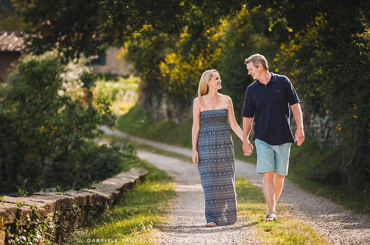 Family portrait of mother and father. Very beautiful light in the agriturismo Villa Il Castellaccio, Greve in Chianti Tuscany.