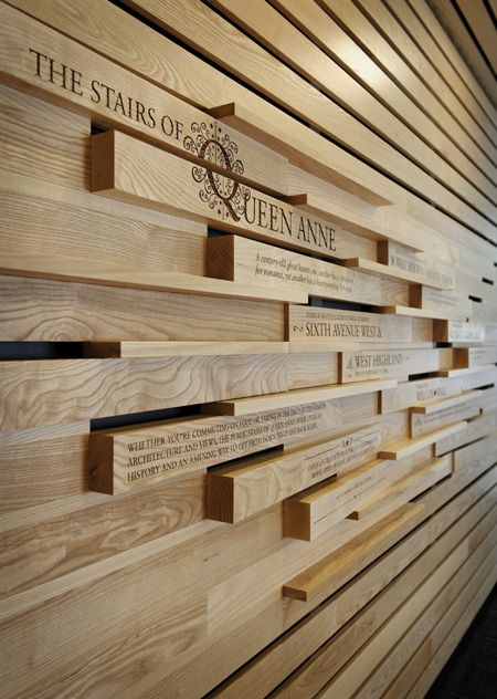 Environmental graphics by Chad Evans, timber slatted cladding with text printed onto the surface