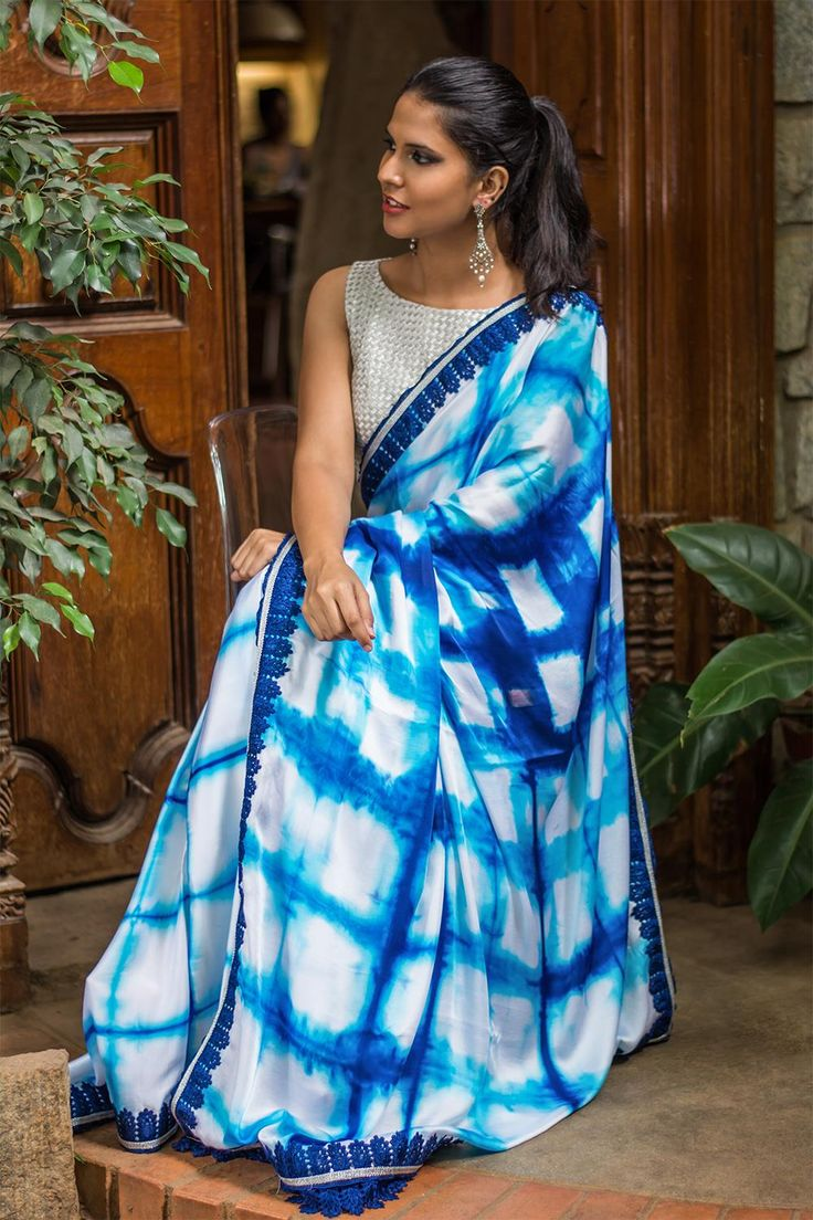 White cotton satin saree with navy blue shibori print and blue lace border #shibori #satin #houseofblous e #saree