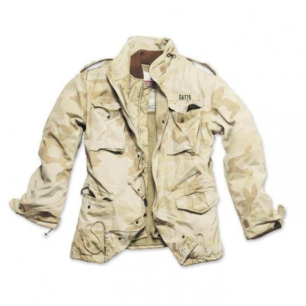 Kurtka wykonana jest z ekstremalnie mocnego splotu bawełny w postaci odpornej na warunki atmosferyczne tkaniny brezentowej. Wyposażona jest w chowany w kołnierzu kaptur zapewniający komfort termiczny głowy i karku. Zapinana na metalowy zamek błyskawiczny i  dodatkowo na zatrzaski.