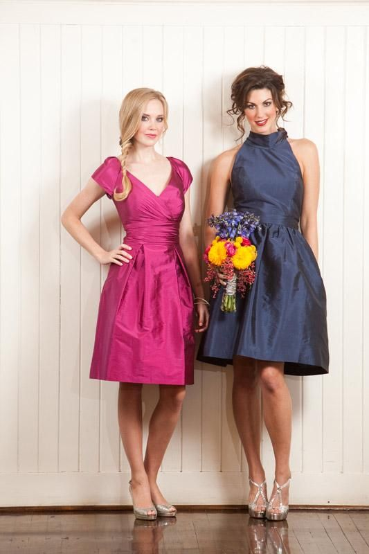 Feminine bridesmaid gowns in fuchsia and navy. Alfred Sung dresses available at @Erin B Duncan Rose Bridal and The Bridal Boutique. Photo by Jesse Reich Photography. #wedding #bridesmaid #dress #fashion #pink #navy