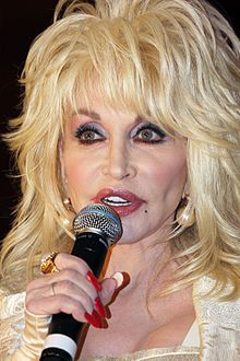 Dolly Parton 2011.jpg LOVE her sweet voice and the beautiful songs she has written; touch the core of my heart! She reminds me a bit like me; I love hair and make-up and will darned well dress to suit me!
