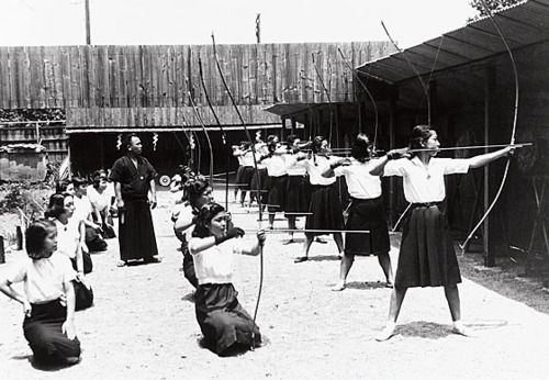 Kyudo being practiced by women at Doshisha Women's College of Liberal Arts in Kyoto, Japan [1941]
