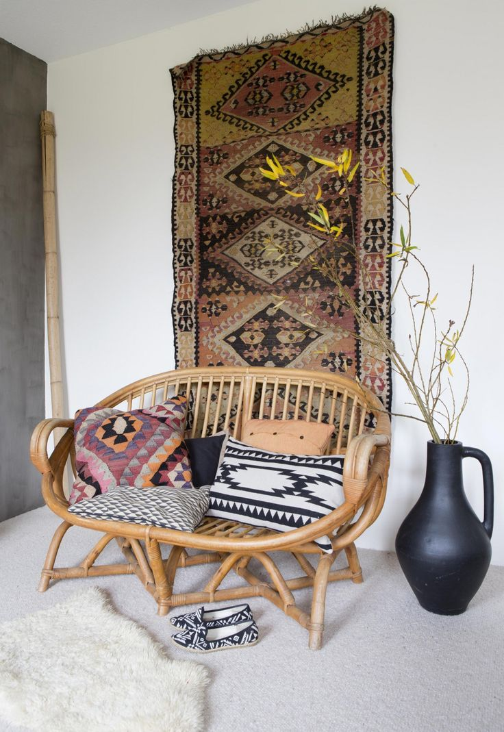 Kilim rug and awesome wicker chair.