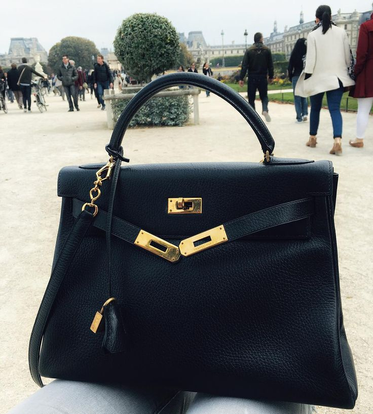 Hermes Kelly. black, with gold hardware & a strap I finally found it from @bellabag