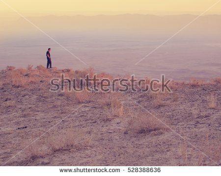 explorer man on mountain. view.