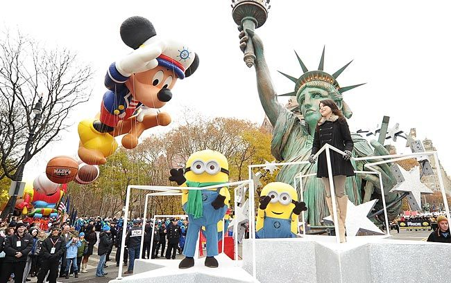 Actress/singer Miranda Cosgrove and the 'Despicable Me' minions on 2012′s Statue of Liberty float during the 84th annual Macy's Thanksgiving Day Parade