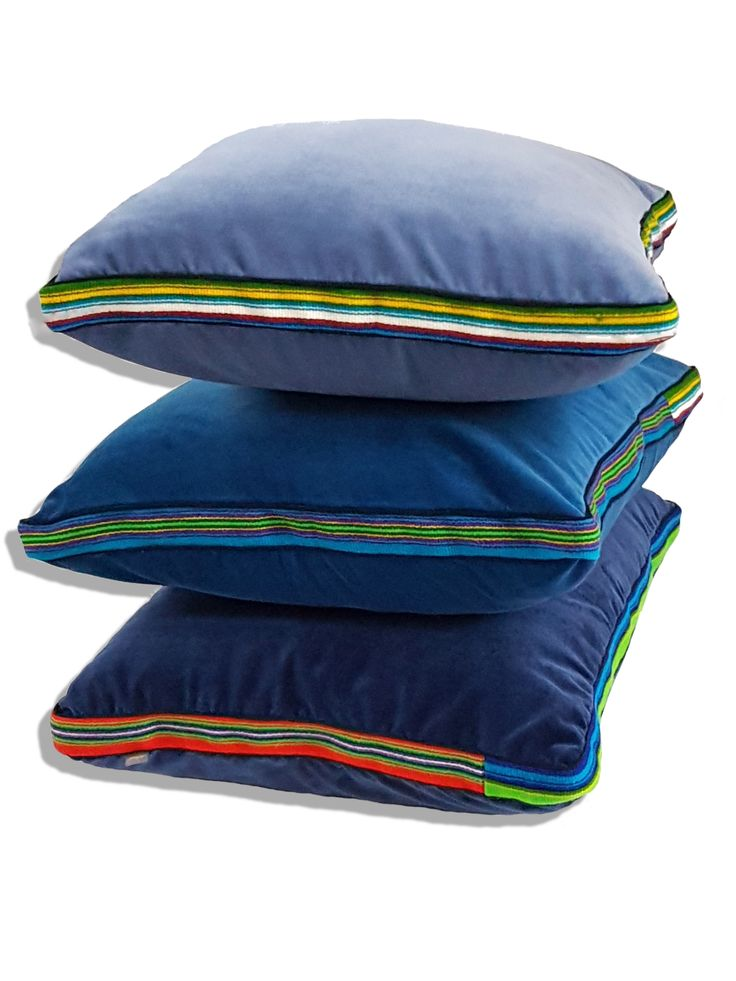Big blue velvet pillows with addition of regional wool fabric by Folka