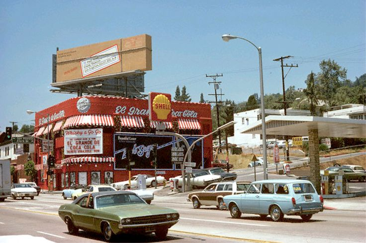 The Whisky a Go Go on the Sunset Strip, featuring El Grande de Coca Cola (1975). Note the Paul Anka billboard. That year, in Los Angeles, I had a Marina Blue VW squareback identical to that seen at the right.