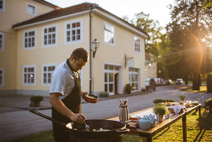 The chef of Galerija Okusov preparing the meals outdoor, in front of the wedding guests. How cool is that?
