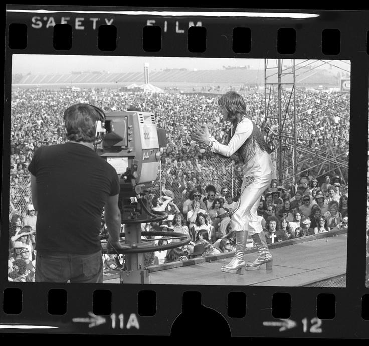 Ozzie Osbourne of Black Sabbath performing before crowd at California Jam concert in Ontario, California, 1974.