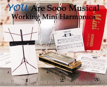 YOU gNeek, LLC - Working Harmonica Necklace with Tiny Music Stand and Sheet Music, (http://www.yougneek.com/working-harmonica-necklace-with-tiny-music-stand-and-ity-bity-sheet-music/)