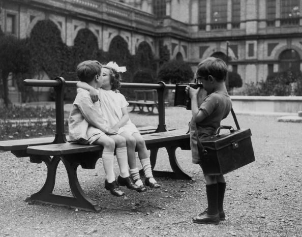 News Photo : A young photographer capturing a kiss on camera...