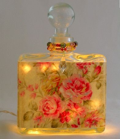 "Measures 6"" x 4"" with the glass top. Our designer perfume bottle night lights are custom handcrafted for you using vintage reproduction papers in the USA. Unbelievable! These are gorgeous perfume bott"