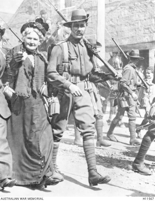 An Australian soldier of the ANMEF and his mother marching to the wharf in Sydney, Aug 8,1914, prior to departing for Rabaul. - H11567 | Australian War Memorial
