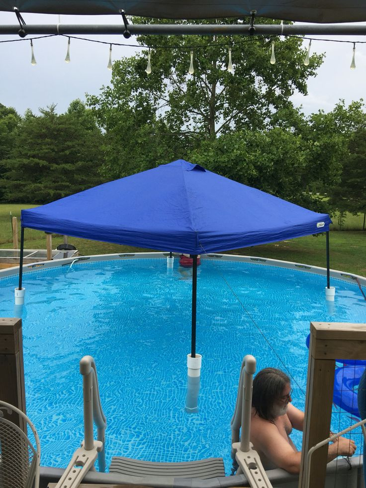 "DIY floating canopy pool shade: 2' long 4"" PVC pipe capped on the bottom and with a connector on the top just to eliminate the rough edges...slip canopy legs in and open it up while in the pool. Tie canopy strings to pool edge to keep it from floating around. We also tied pool noodles in a knot around the top of the pipe, just under the edge of the connector. Viola! Pool shade! More"
